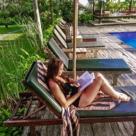 Lounging by the pool at omah apik